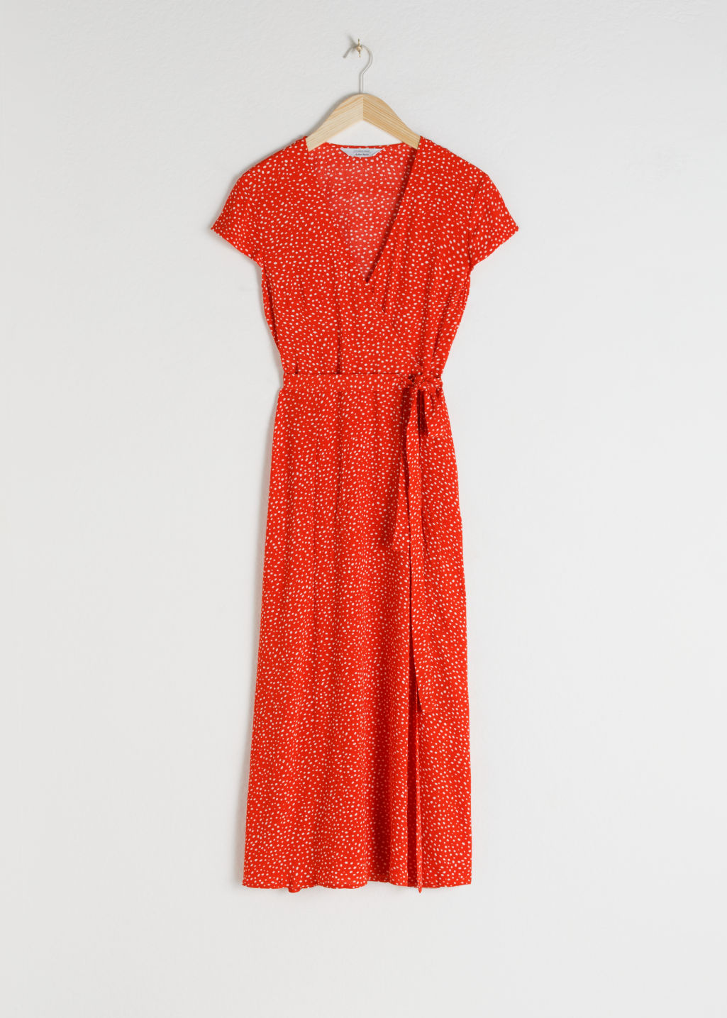 Front image of Stories floral midi wrap dress in red