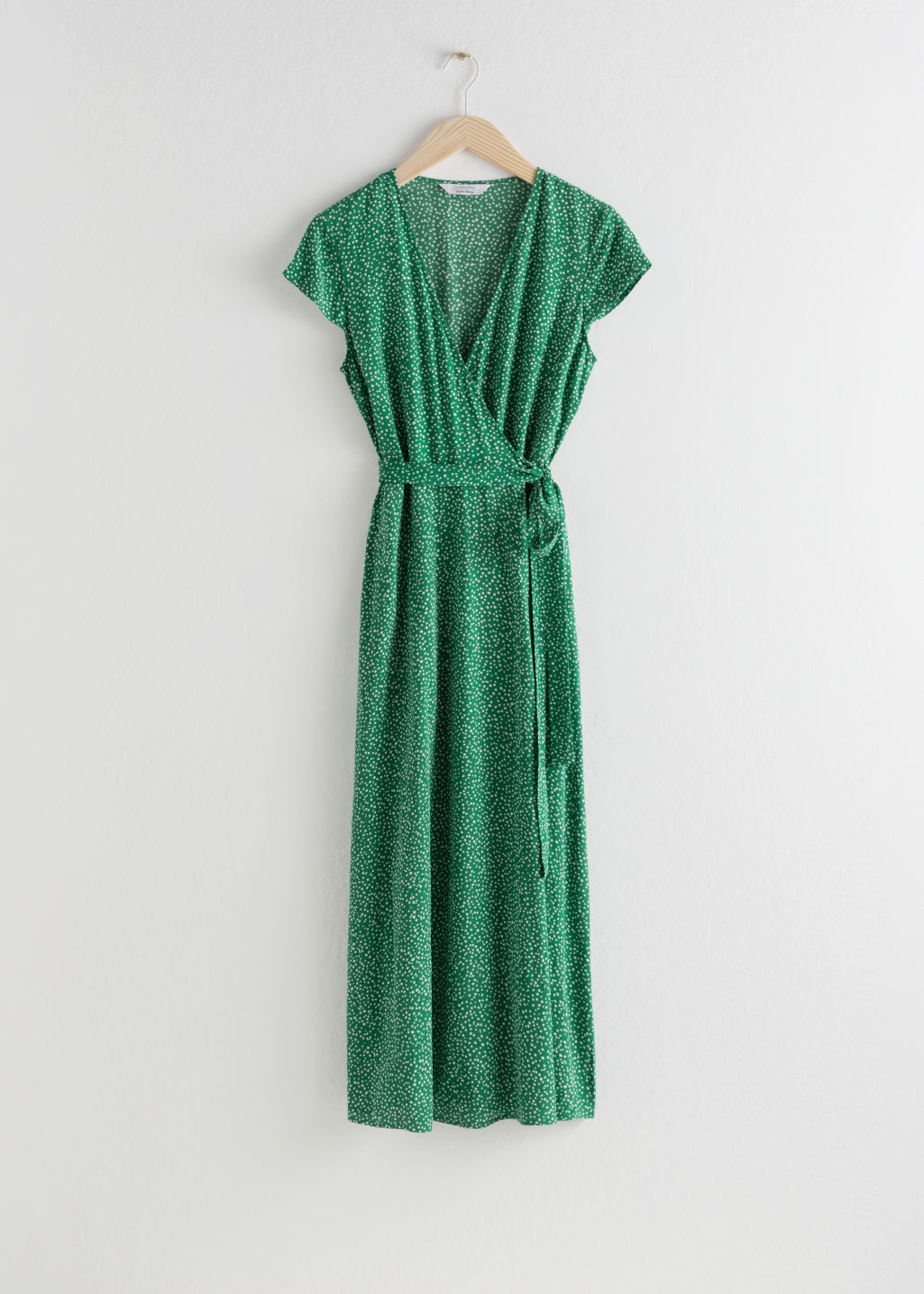 Front image of Stories floral midi wrap dress in green