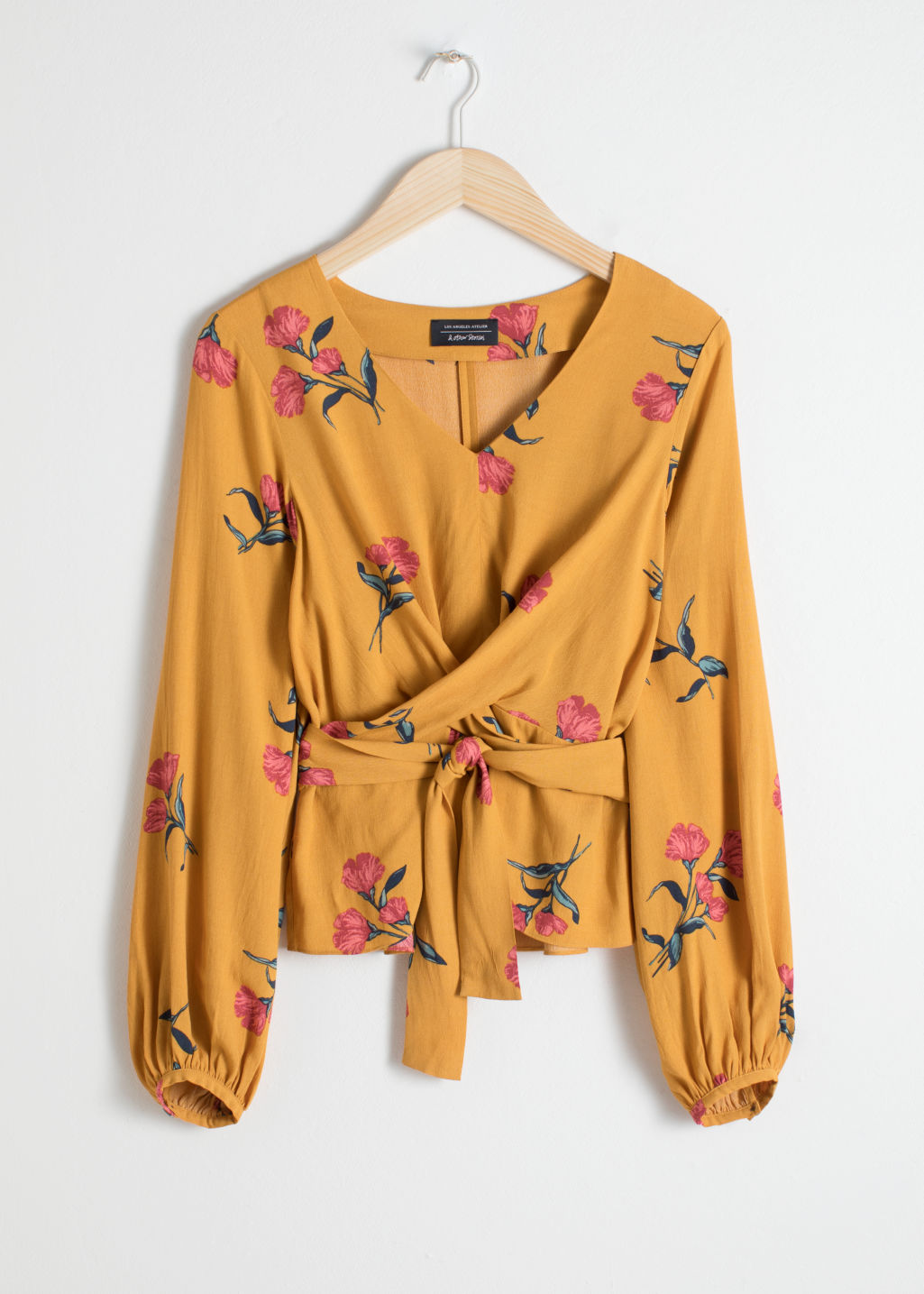 Front image of Stories cross wrap tie blouse in yellow