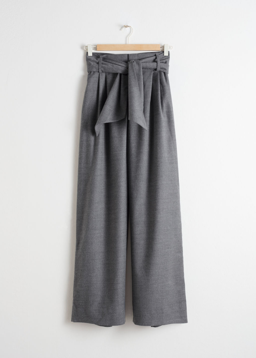 Front image of Stories belted wool blend trousers in grey