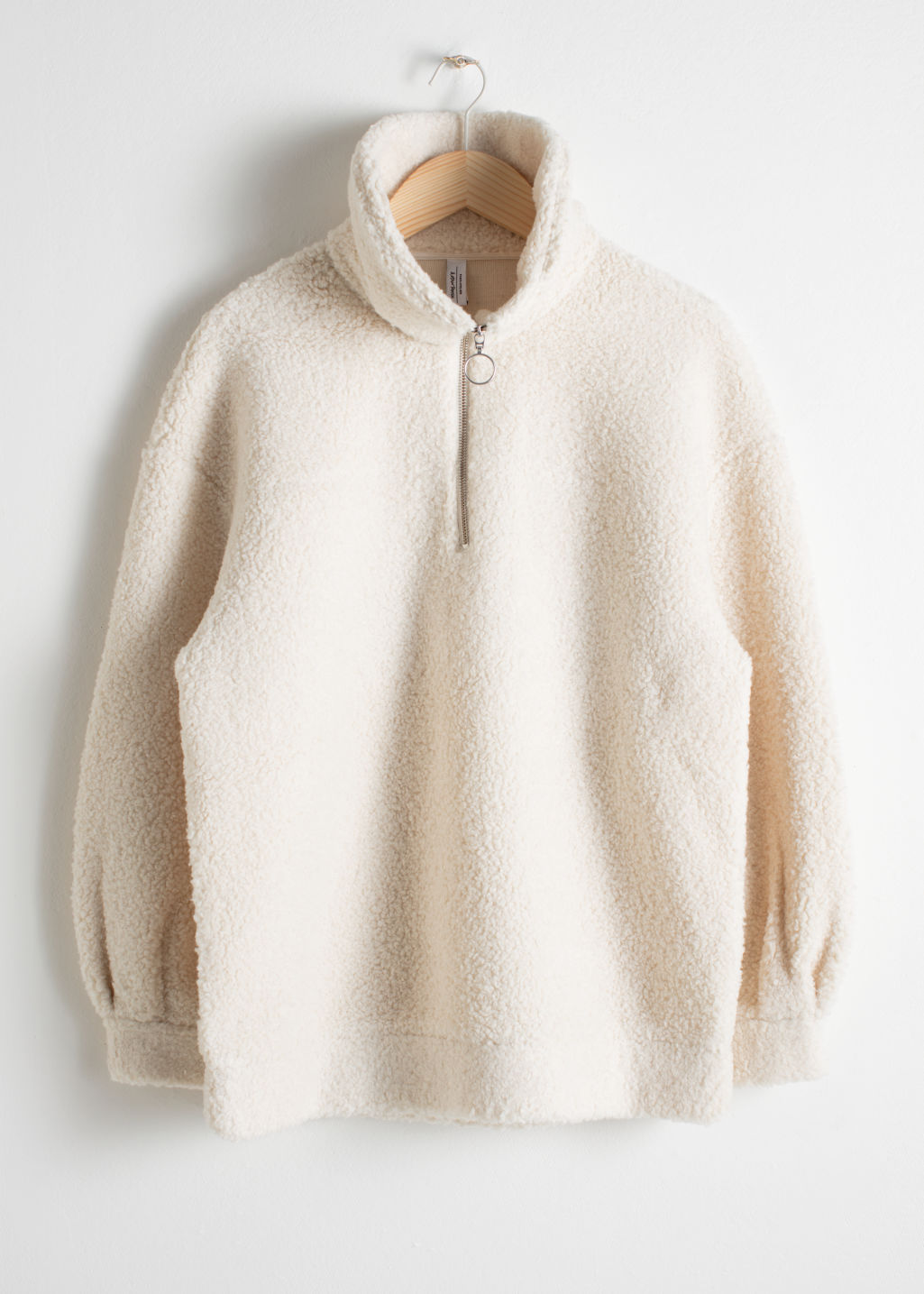 Front image of Stories faux shearling zip pullover in white