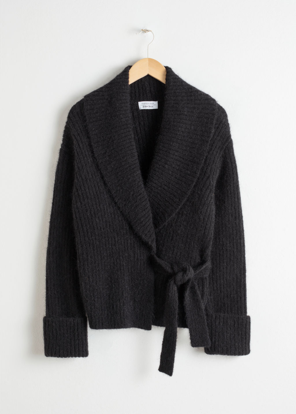 Front image of Stories wool blend wrap cardigan in black