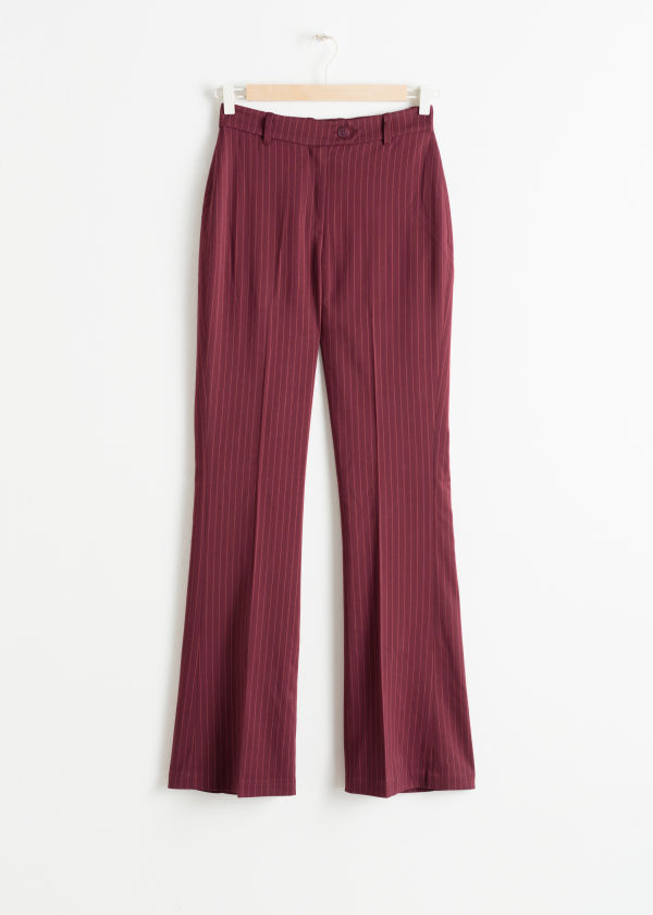Front image of Stories kick flare pinstripe trousers in red