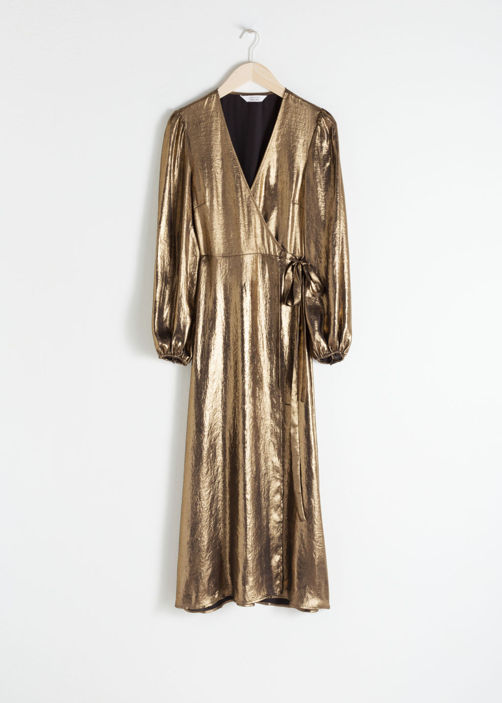 Front image of Stories metallic satin midi dress in gold