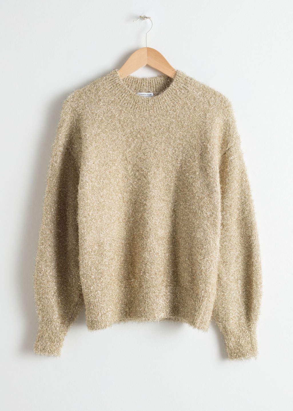 Front image of Stories fuzzy metallic sweater in gold