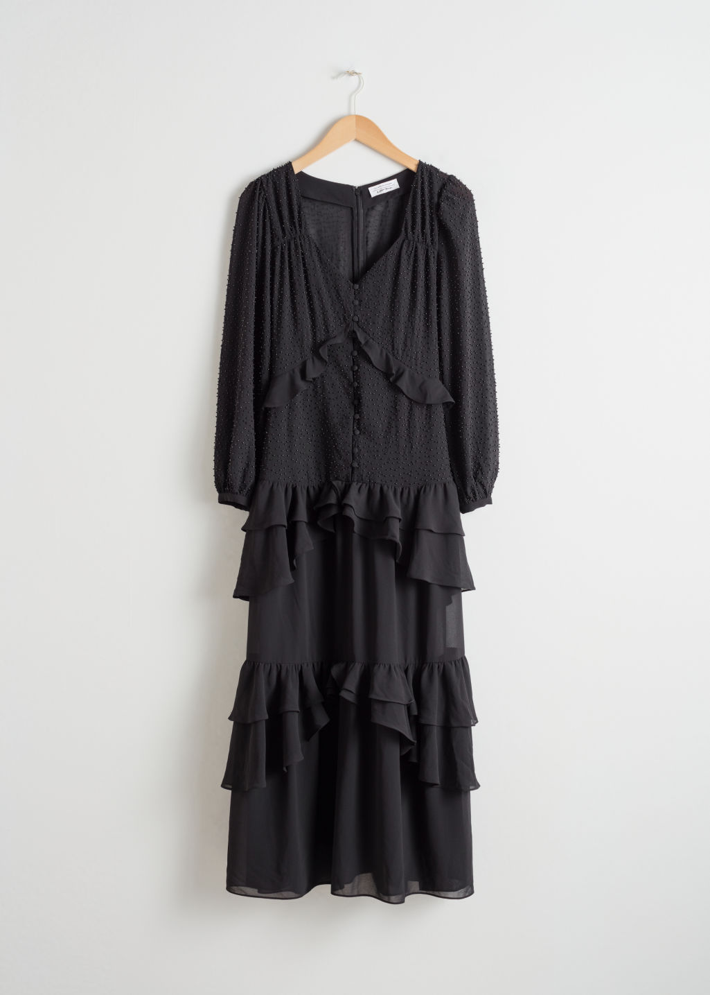 Front image of Stories beaded ruffle midi dress in black