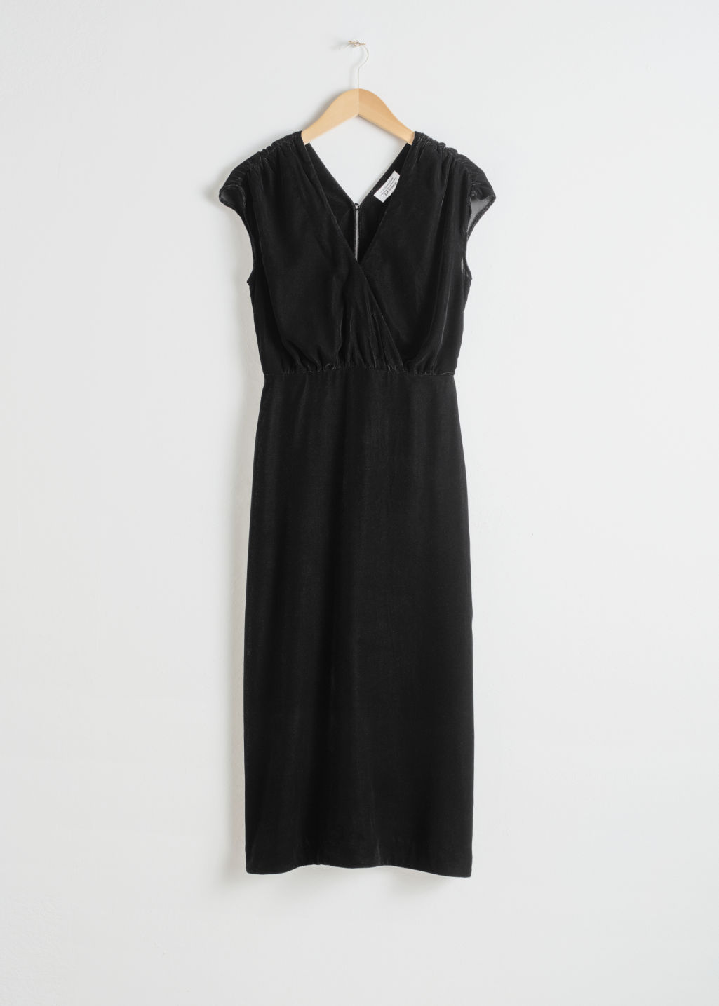 Front image of Stories sleeveless velvet midi dress in black