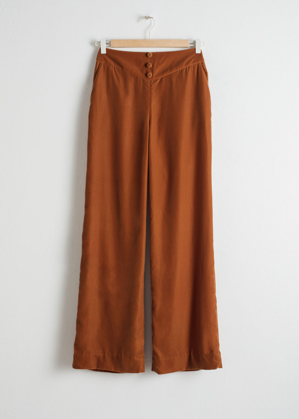 Front image of Stories high waisted velvet trousers in orange