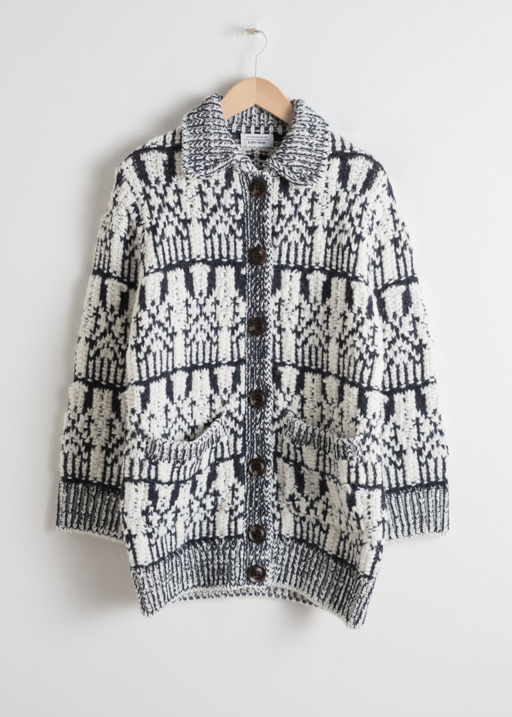 Front image of Stories oversized chunky knit cardigan in white
