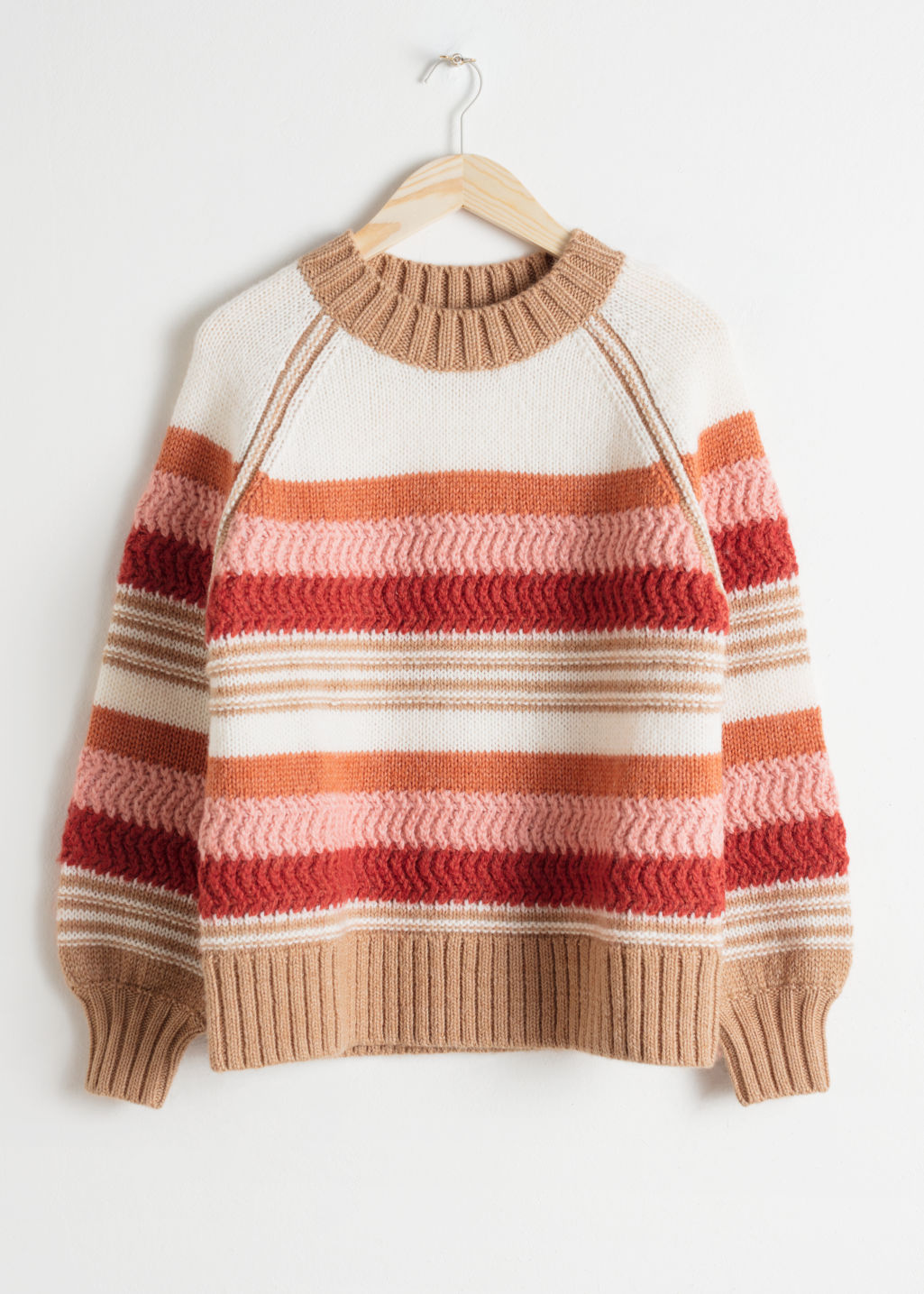 Front image of Stories striped wool blend sweater in white