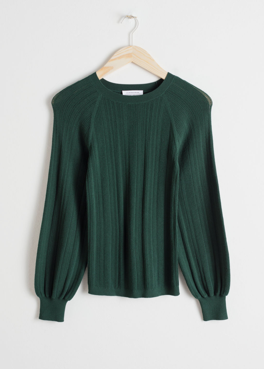 Front image of Stories eyelet knit sweater in green