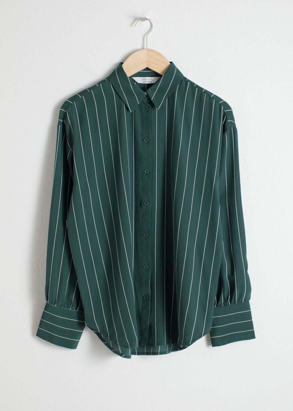 Front image of Stories striped silk shirt in green