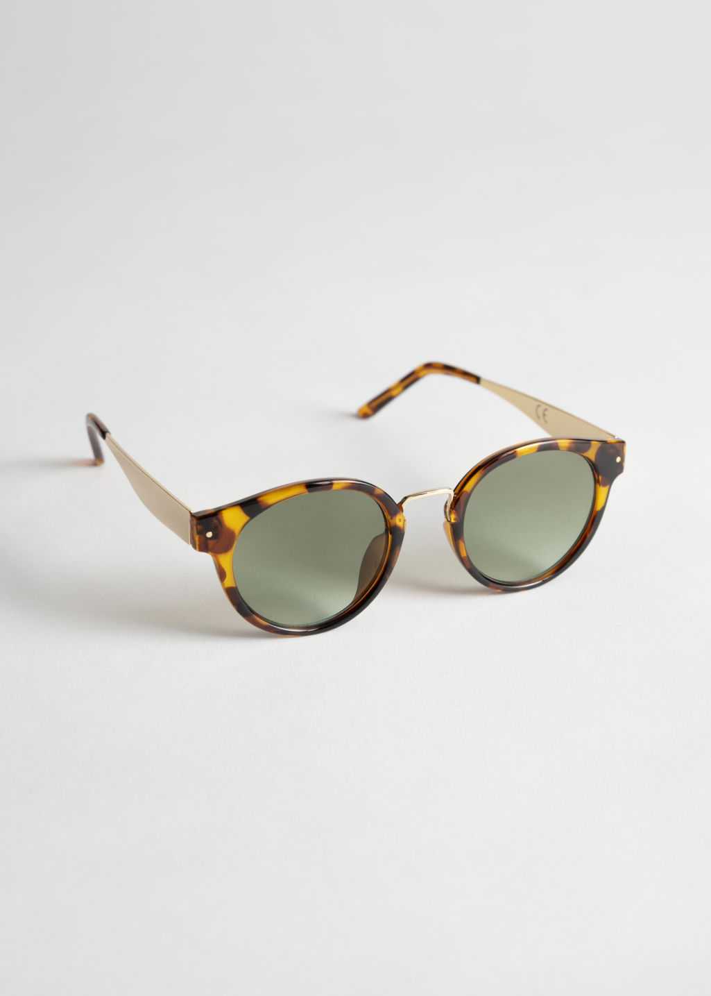 StillLife Front Image of Stories Rounded Gold Bridge Sunglasses in Beige