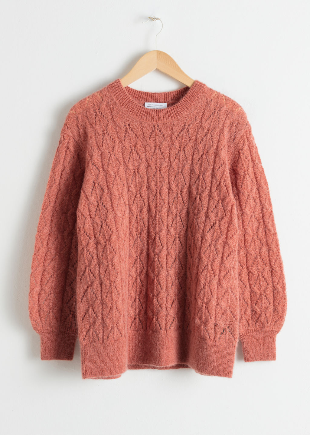 Front image of Stories oversized eyelet knit sweater in orange