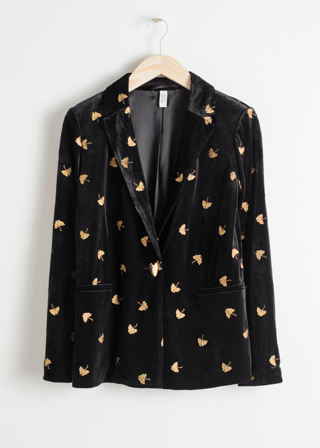 Front image of Stories embroidered velvet blazer in black
