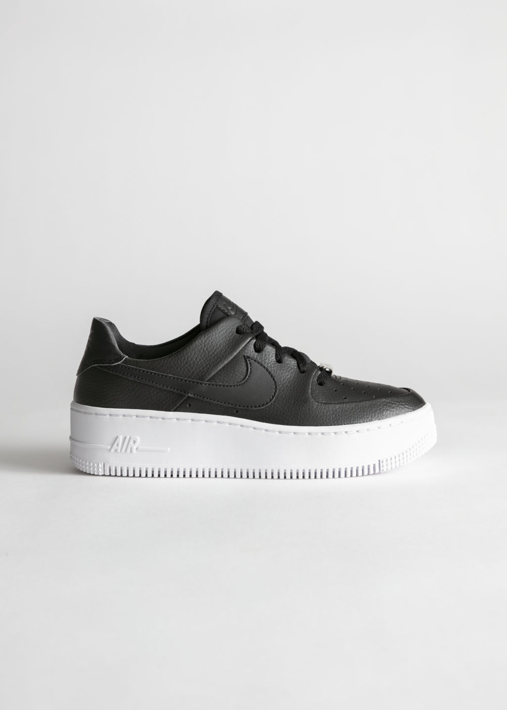 Front image of Stories nike air force 1 low in black