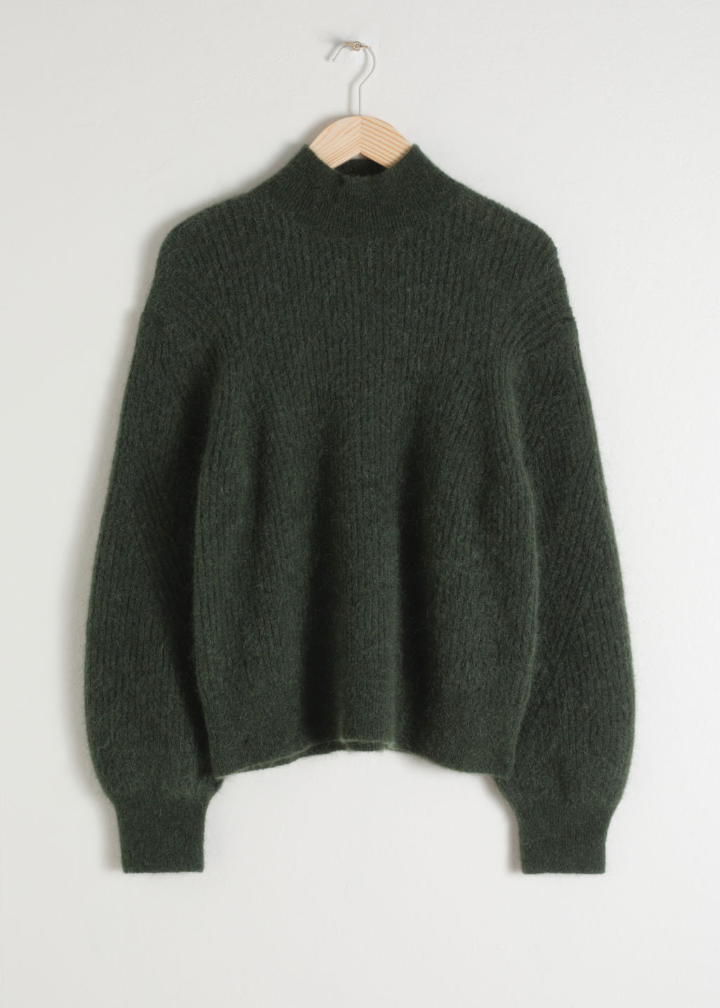 Front image of Stories wool blend cable knit sweater in green