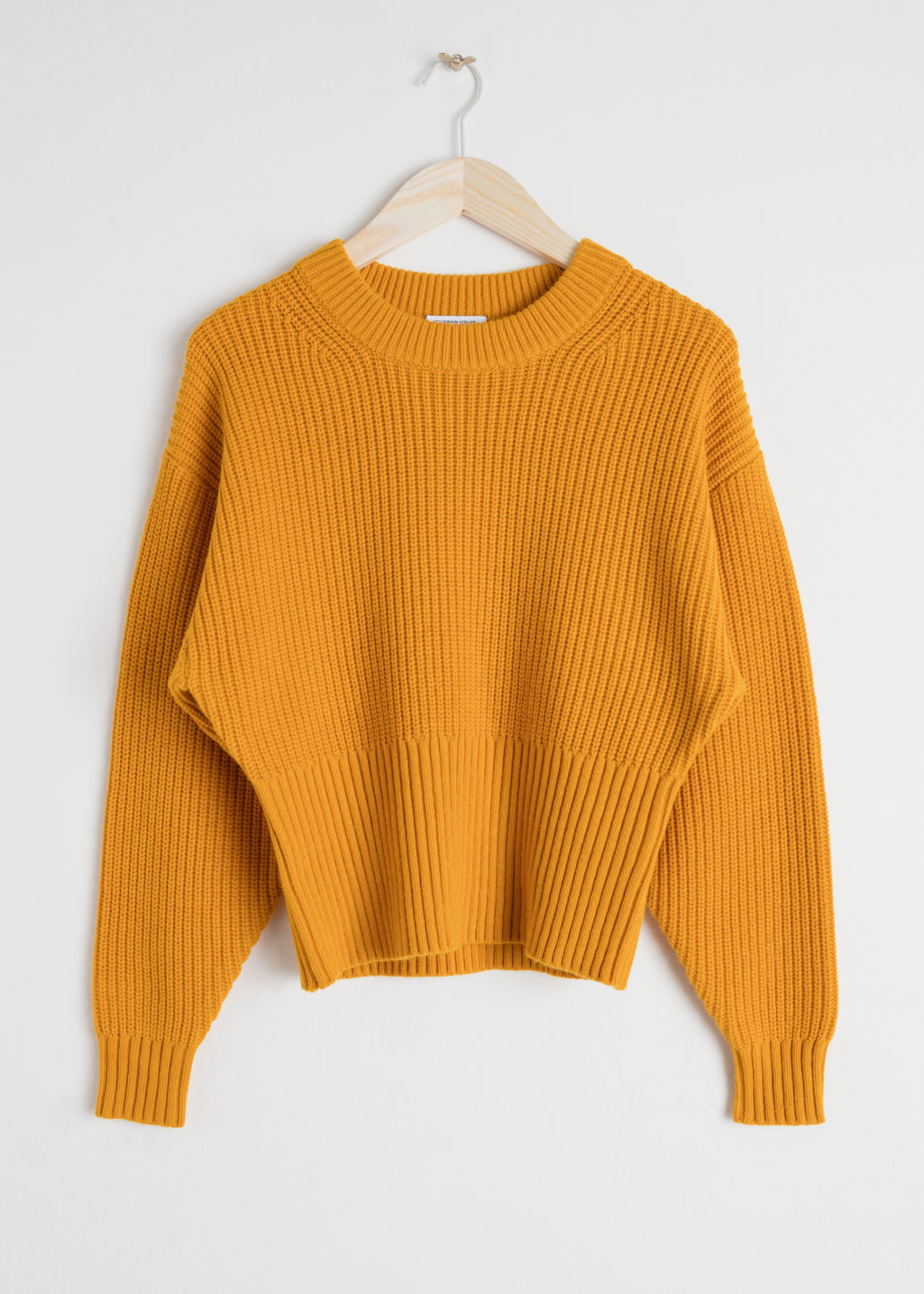 Front image of Stories long rib cropped sweater in yellow