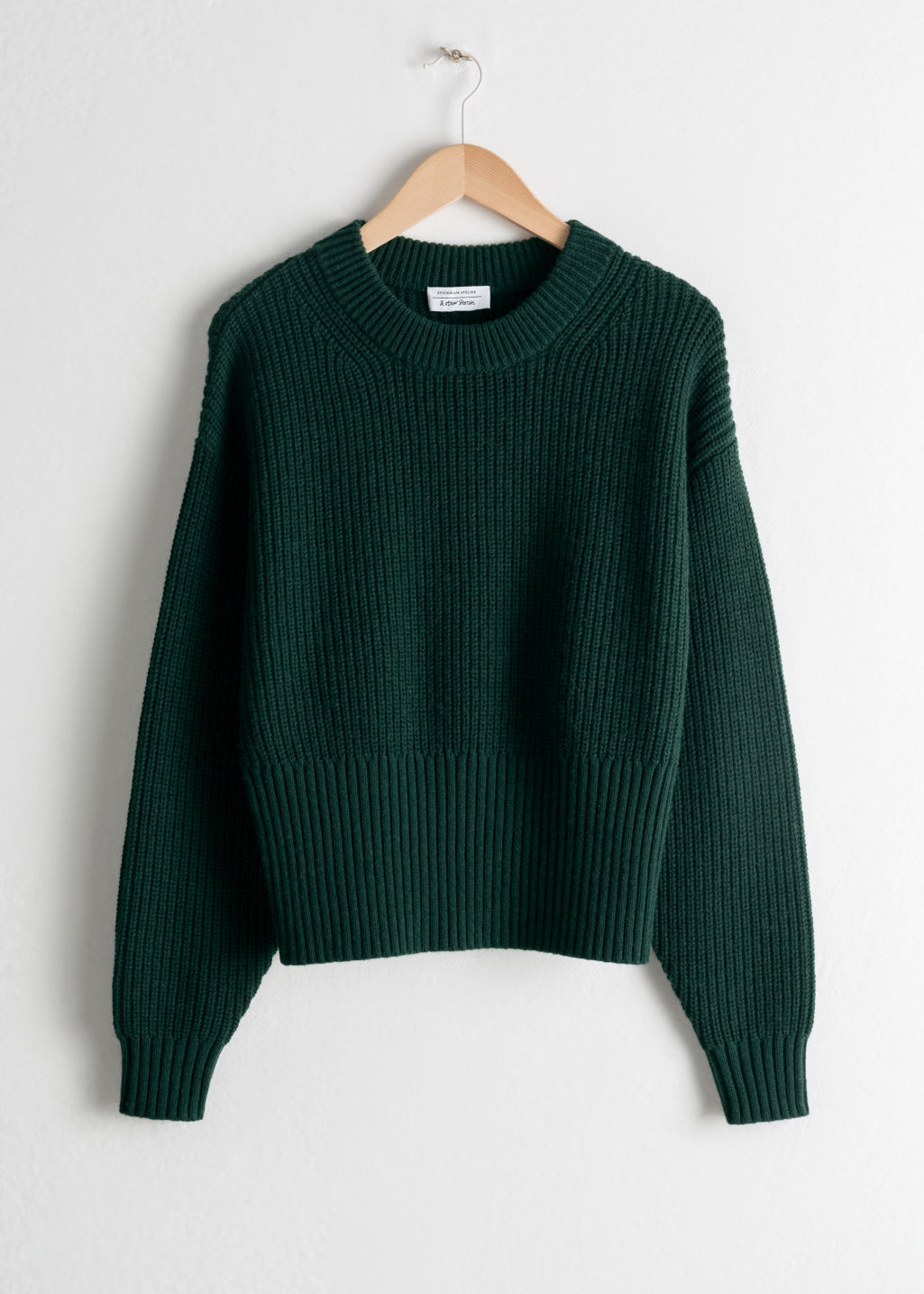 Front image of Stories long rib cropped sweater in green
