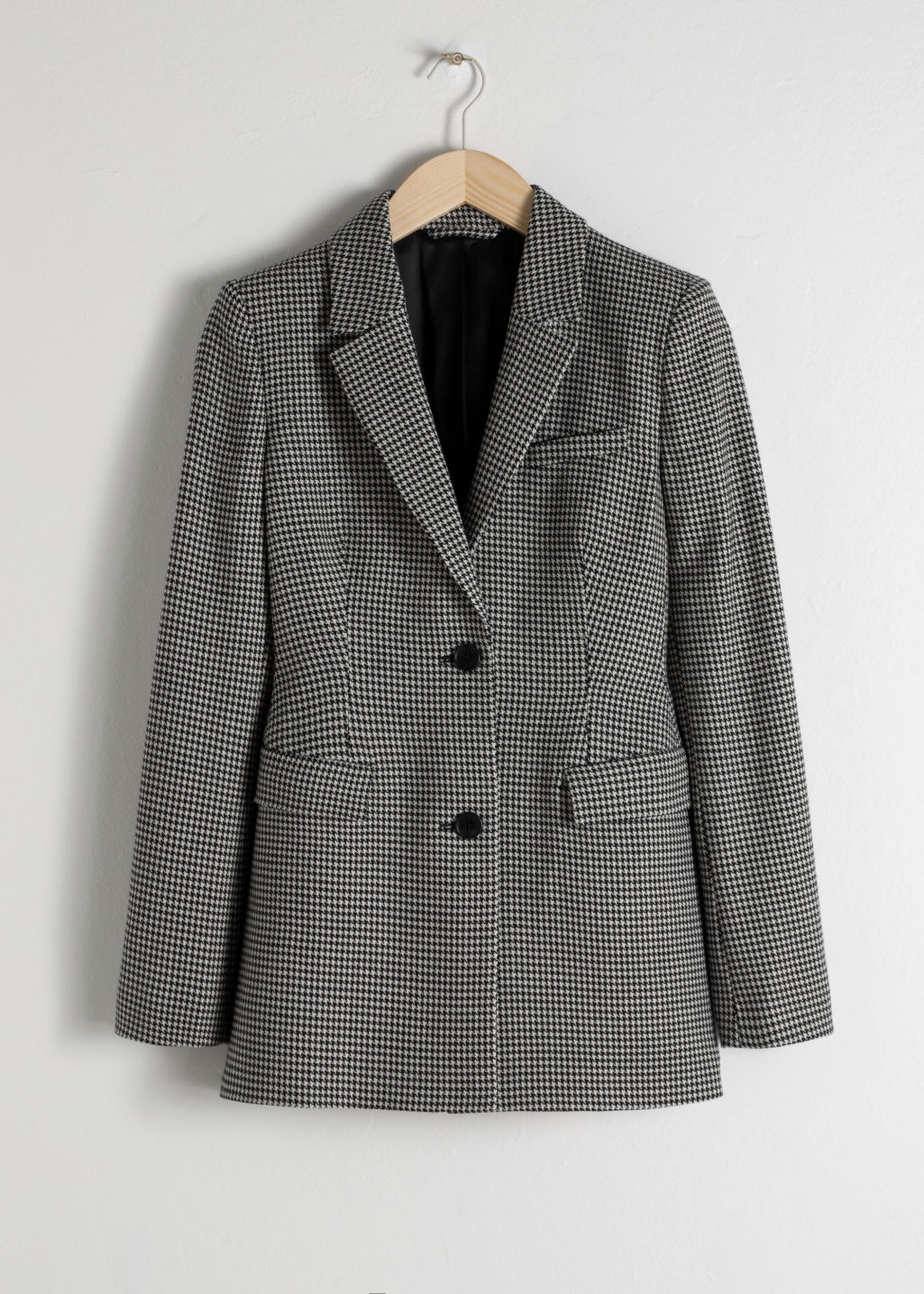 Front image of Stories hourglass houndstooth blazer in black