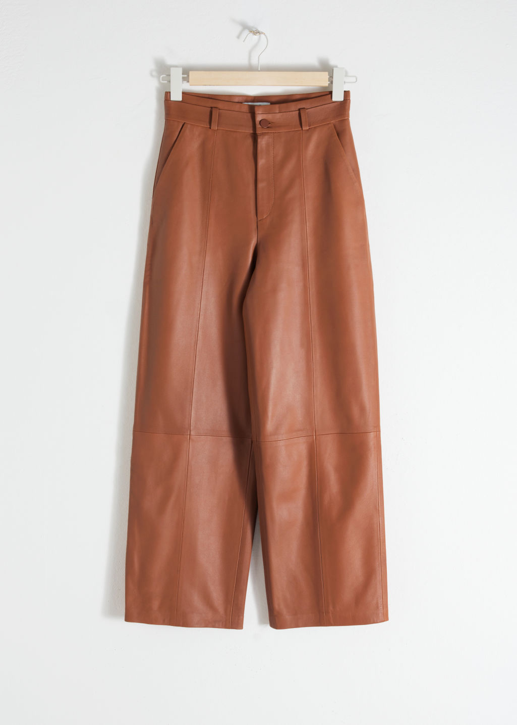 Front image of Stories high waisted leather trousers in orange