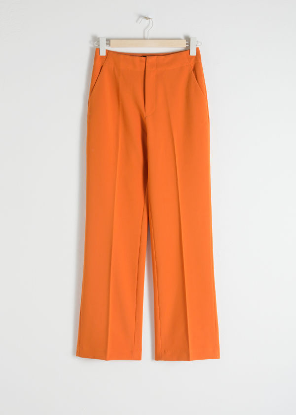Front image of Stories mid rise tailored trousers in orange