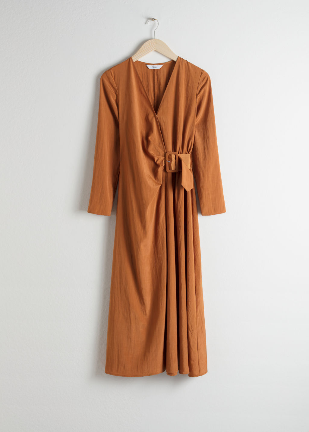 Front image of Stories belted midi wrap dress in orange