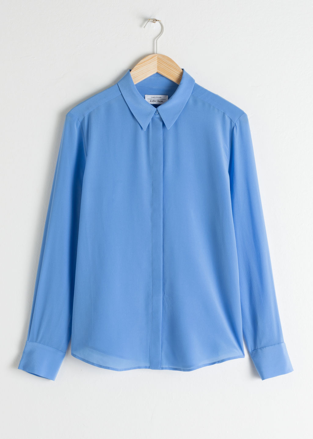Front image of Stories straight fit silk shirt in blue