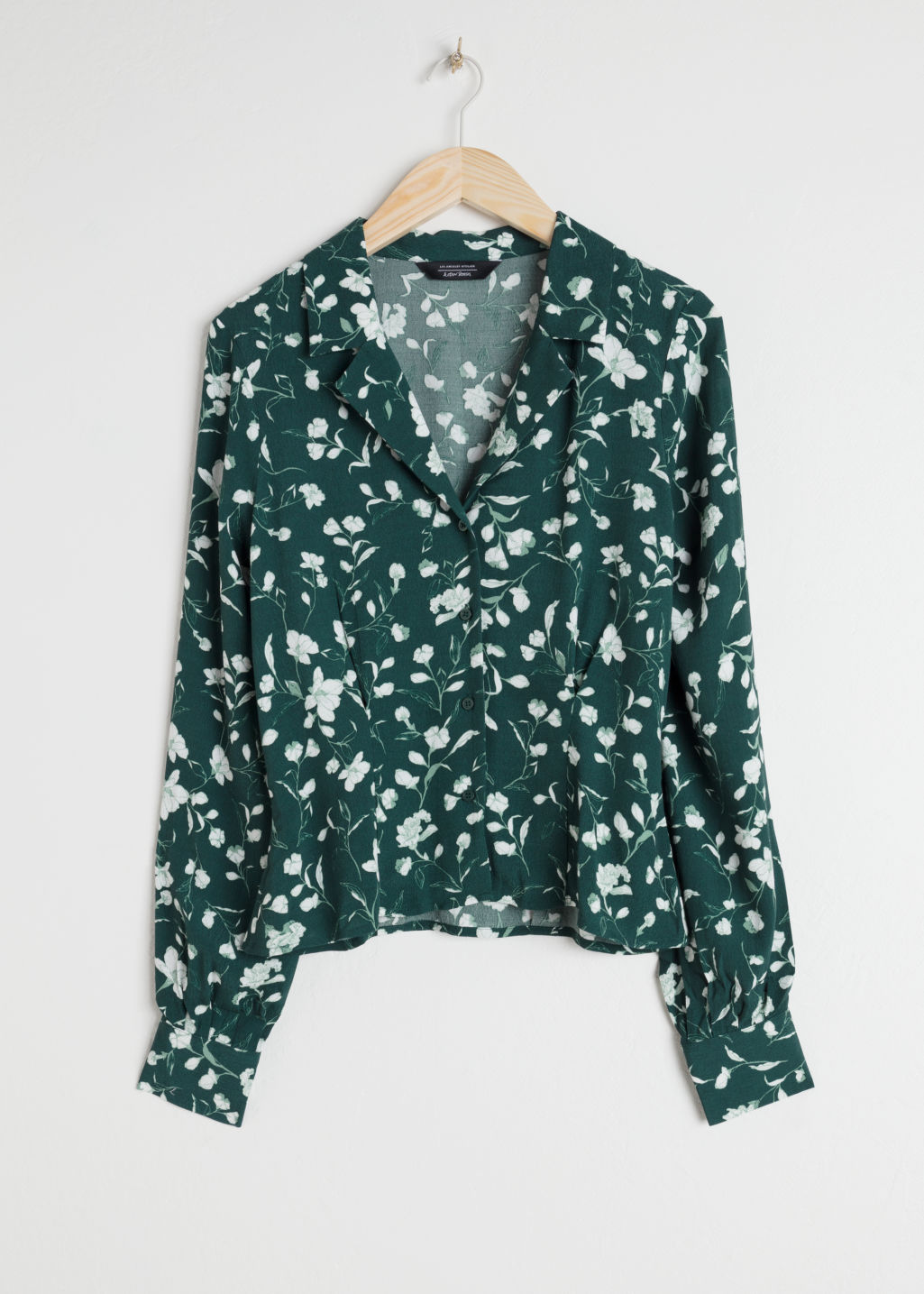 Front image of Stories printed v-cut button down blouse in green