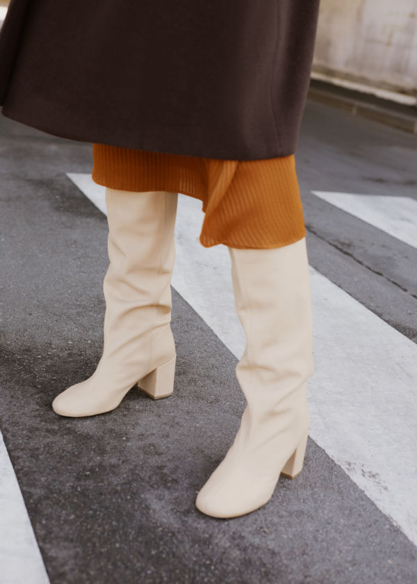 Front image of Stories knee high leather boots in beige