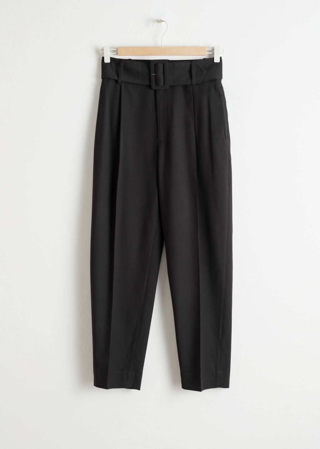 Front image of Stories tapered belted trousers in black