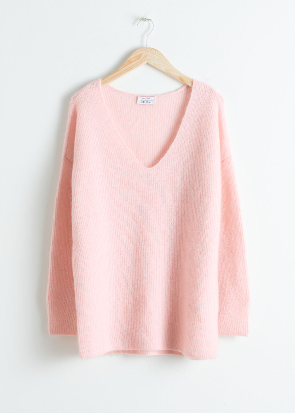 Front image of Stories oversized wool blend sweater in pink