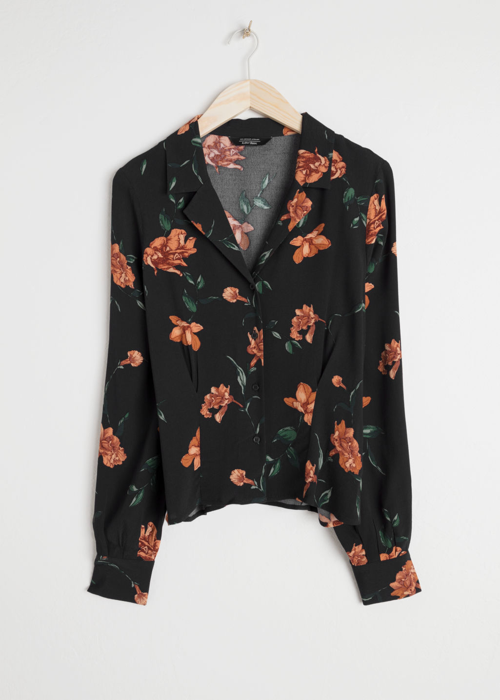 Front image of Stories printed v-cut button down blouse in black