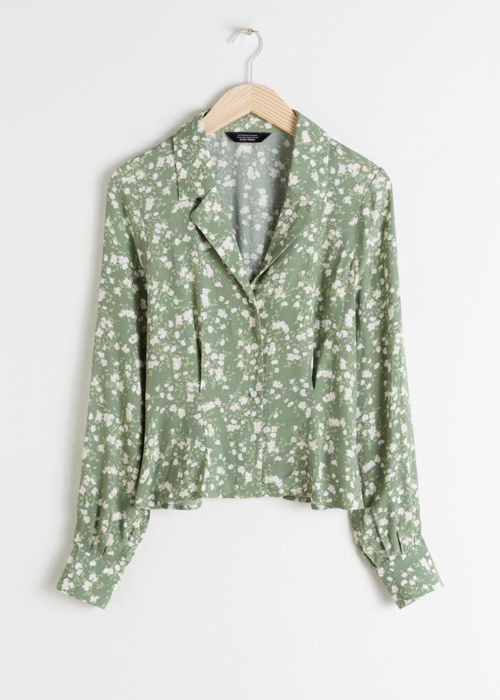 Front image of Stories printed v-cut button up blouse in green