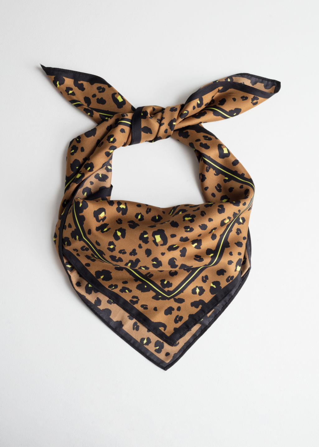 Front image of Stories leopard print neck scarf in beige