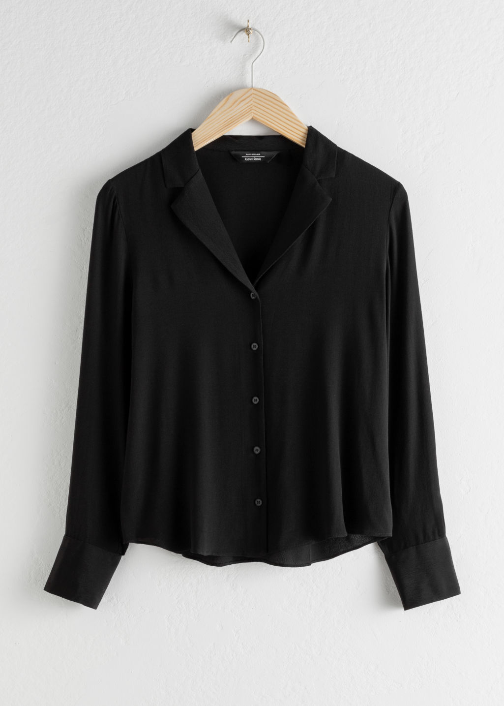 Front image of Stories v-neck button down blouse in black