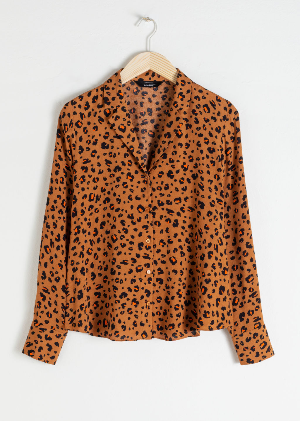 Front image of Stories v-neck button up blouse in orange