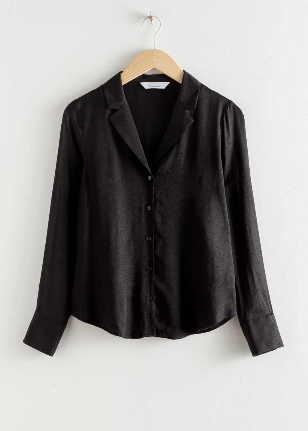 Front image of Stories v-neck button up blouse in black