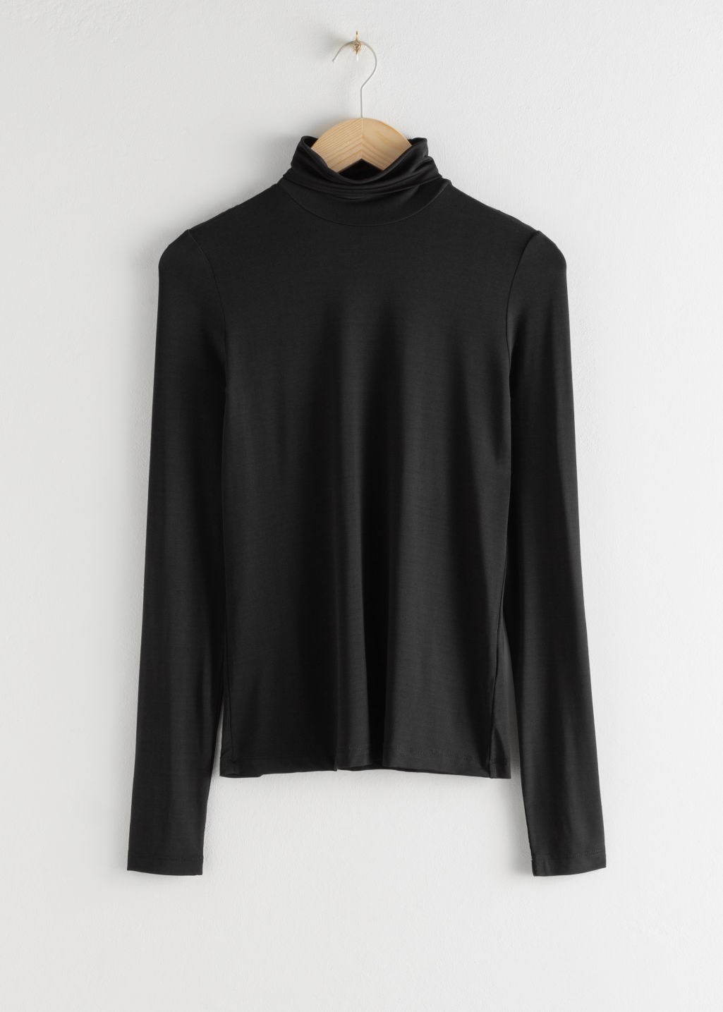 Front image of Stories fitted stretch turtleneck in black