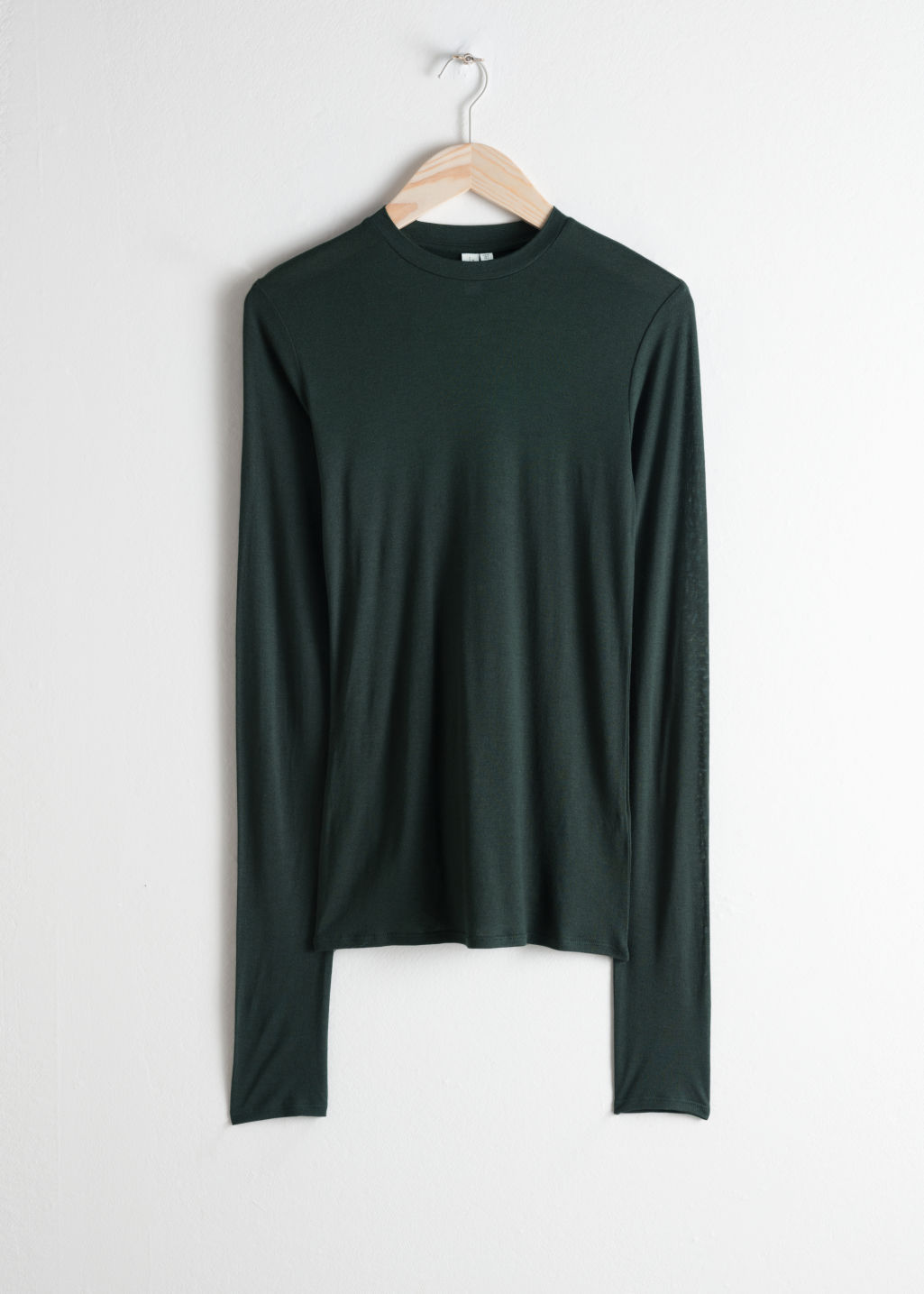 Front image of Stories semi-sheer fitted top in green