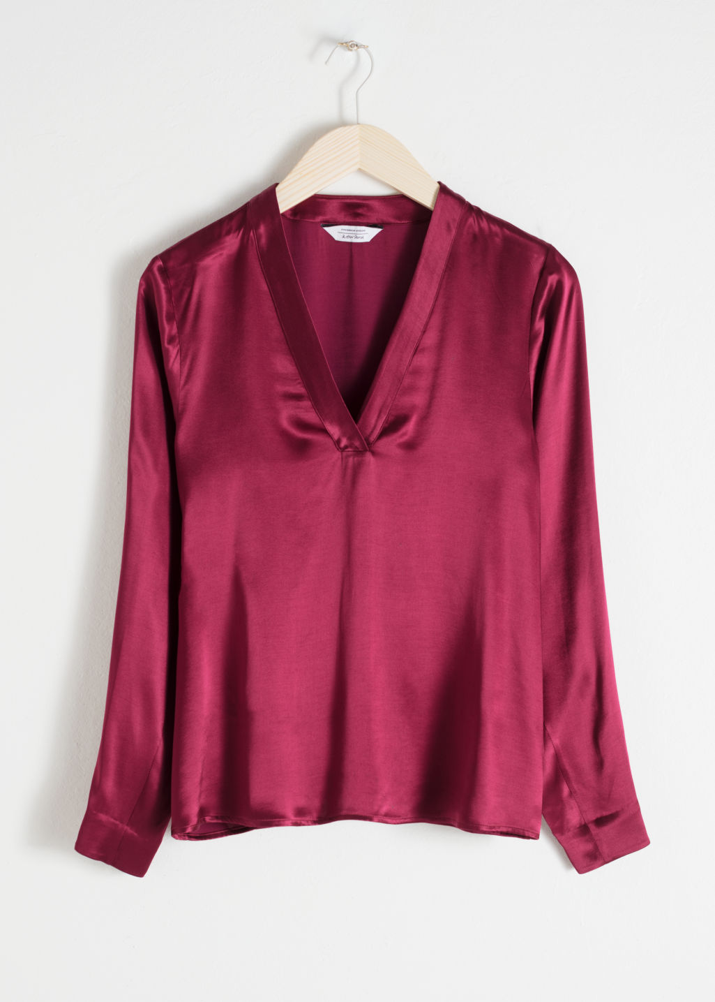 Front image of Stories v-neck satin blouse in red