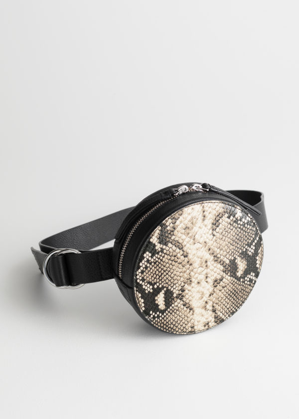 Front image of Stories snake print circle bumbag in black