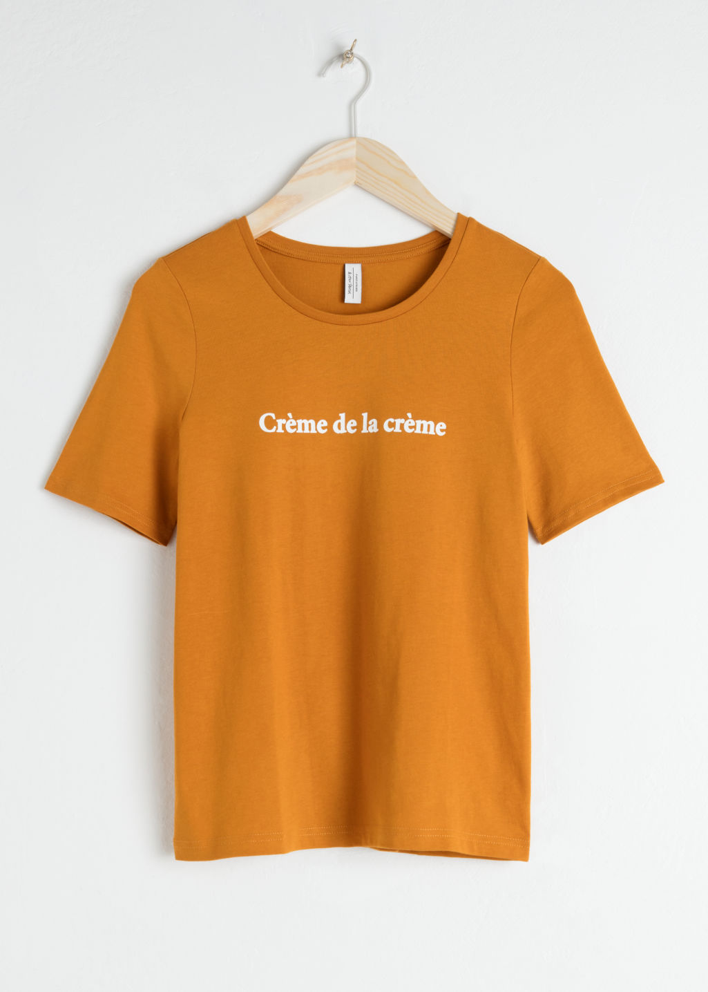 Front image of Stories crème de la crème tee in yellow