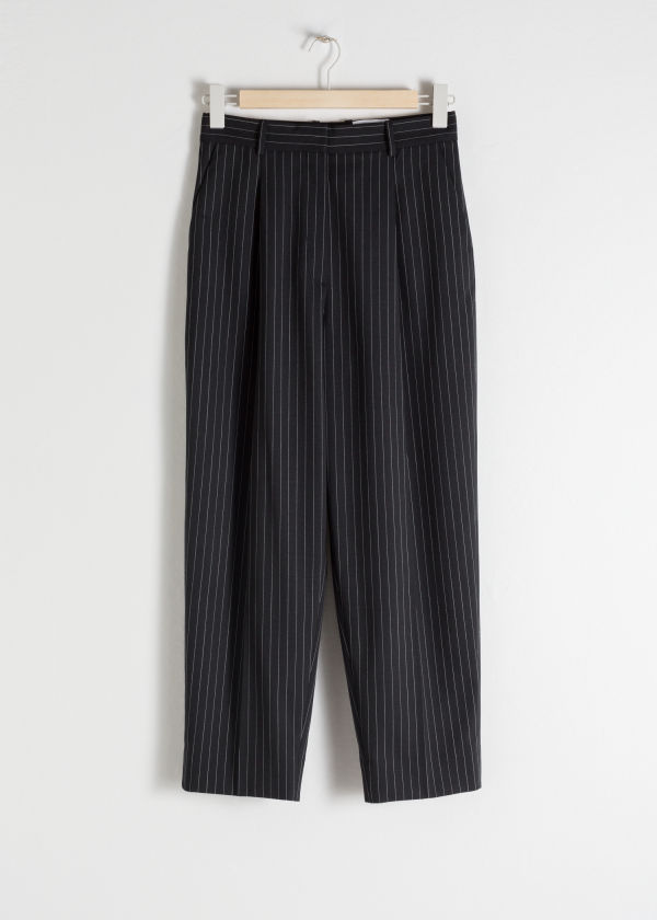 Front image of Stories tapered varsity stripe trousers in black