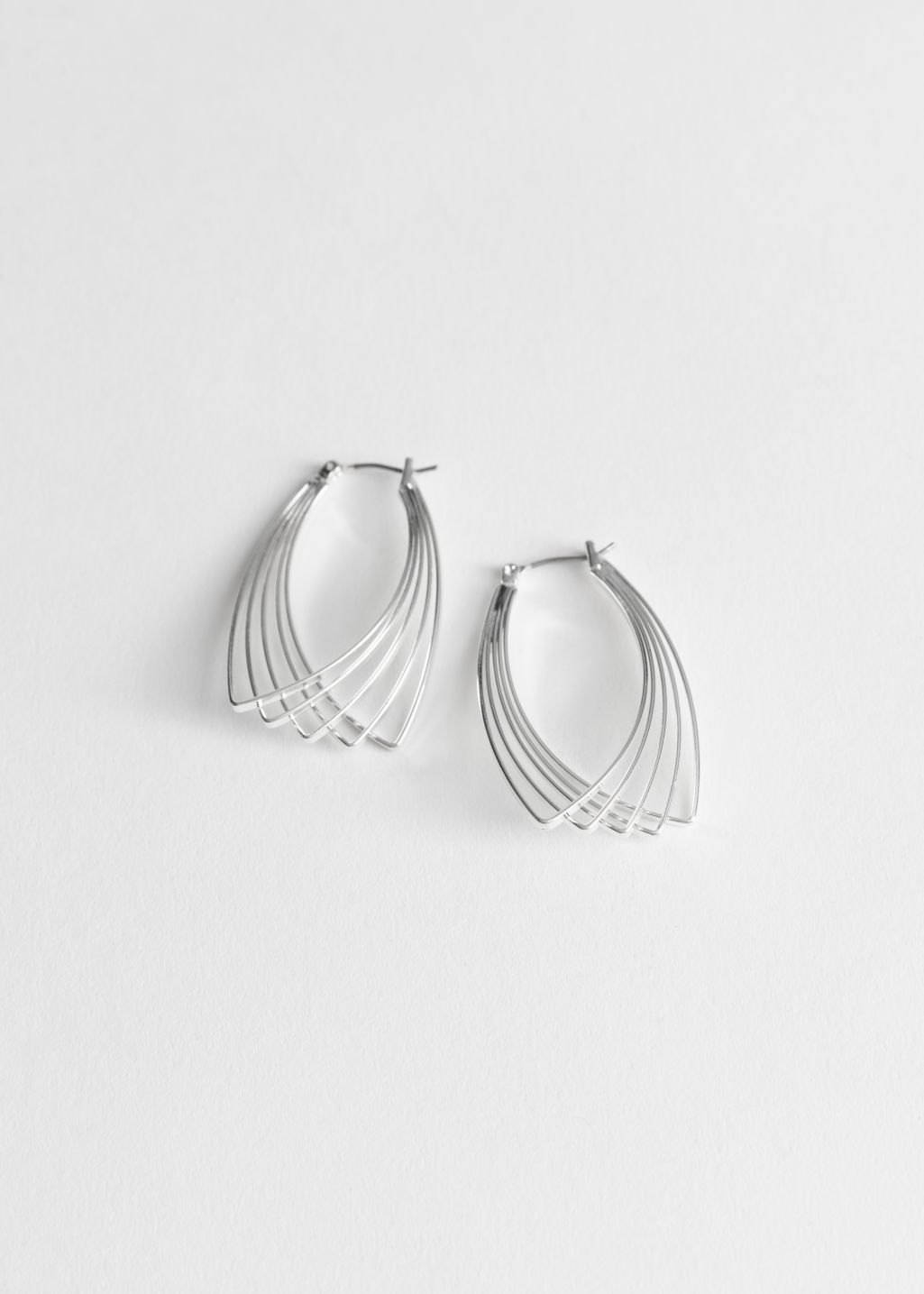 Front image of Stories overlapping wire earrings in silver