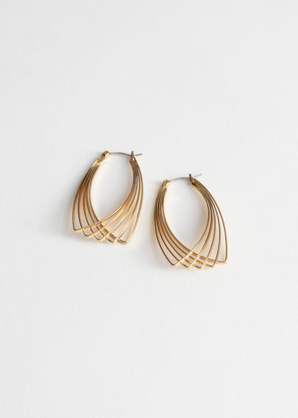Front image of Stories overlapping wire earrings in gold