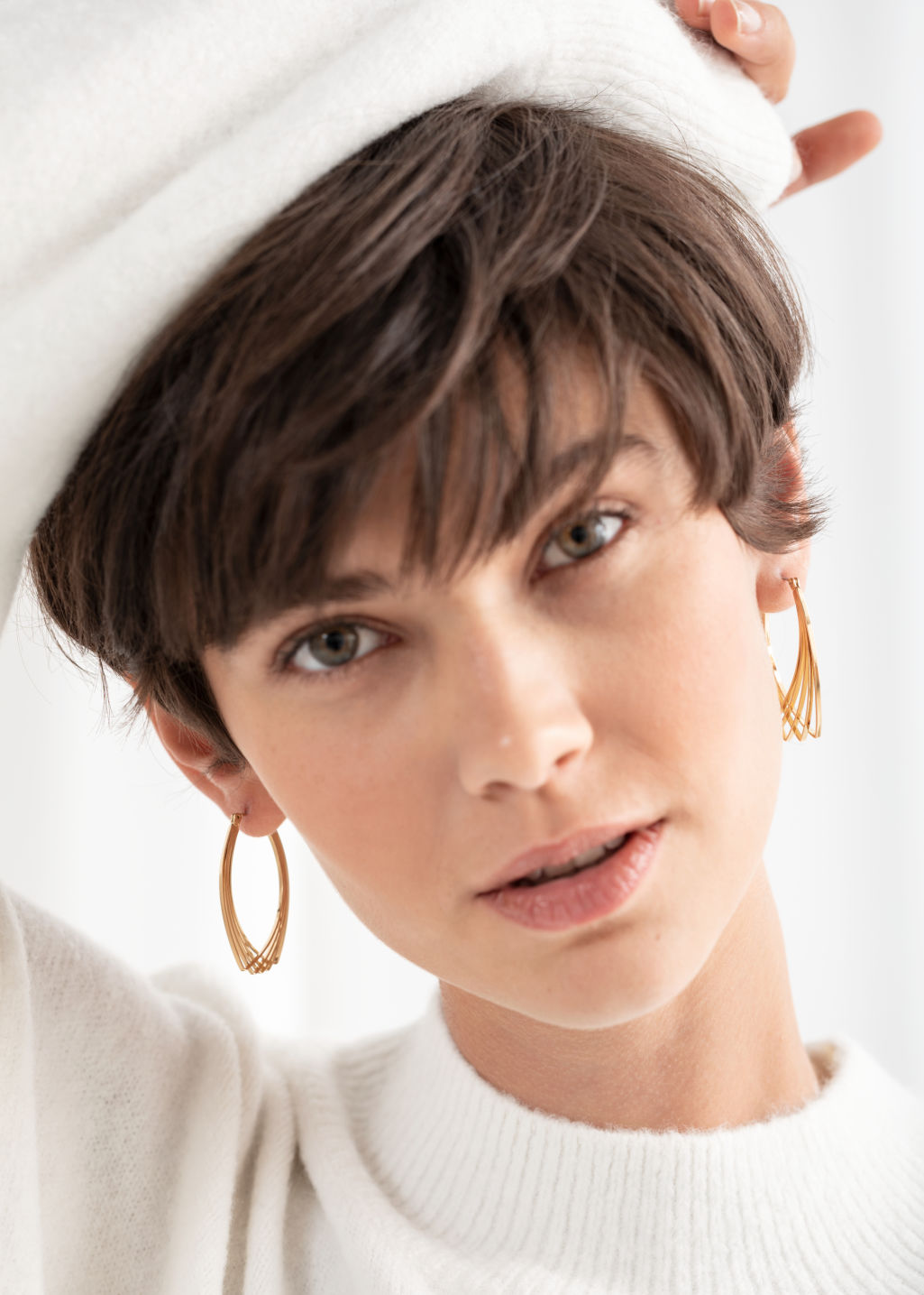 Back image of Stories overlapping wire earrings in gold
