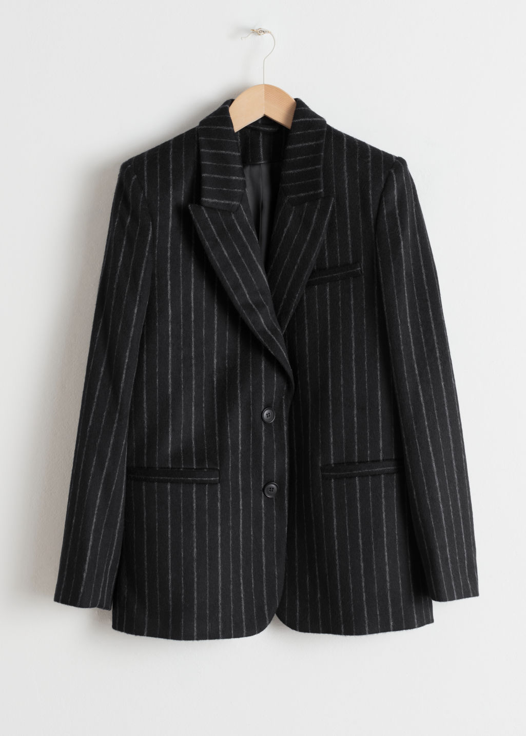 Front image of Stories wool blend pinstripe blazer in black