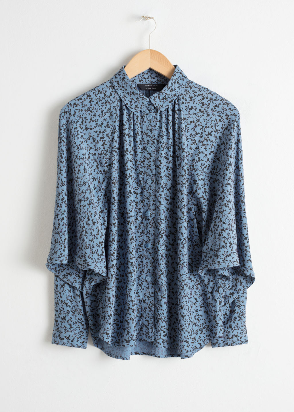 Front image of Stories oversized floral print shirt in blue