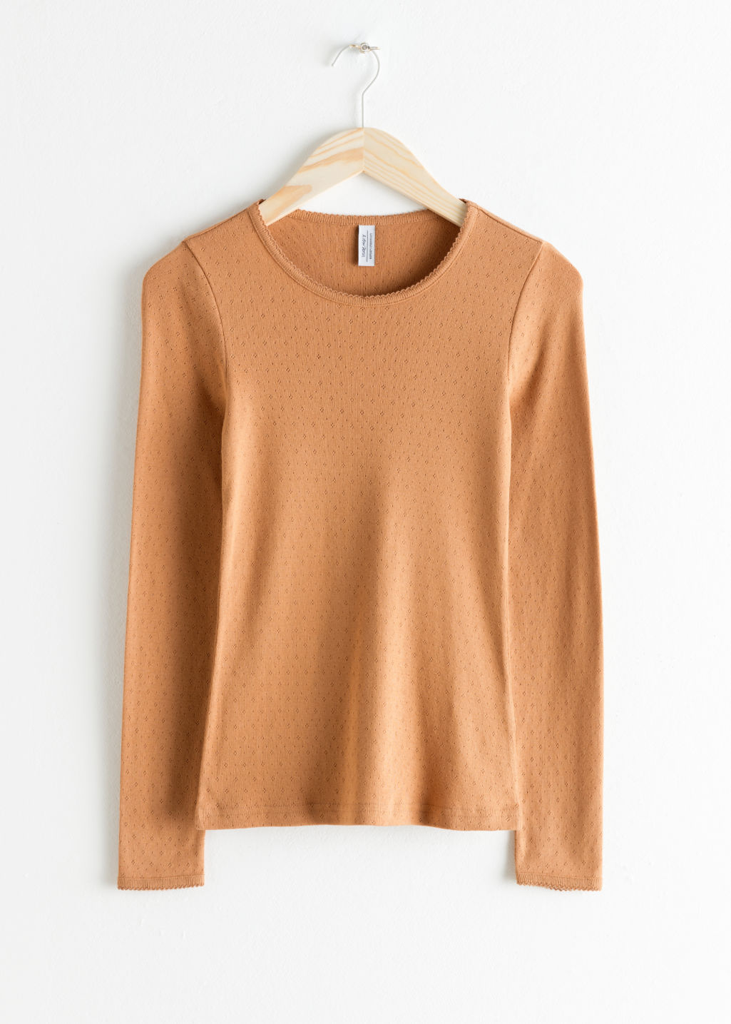 Front image of Stories long sleeve fitted eyelet tee in orange